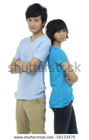 young woman and man standing back to back
