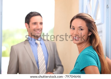 Young woman and real estate promoter - stock photo