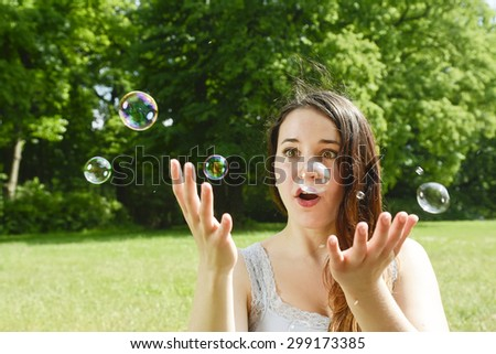 Young woman and soap bubbles
