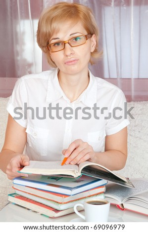 young woman and stack book