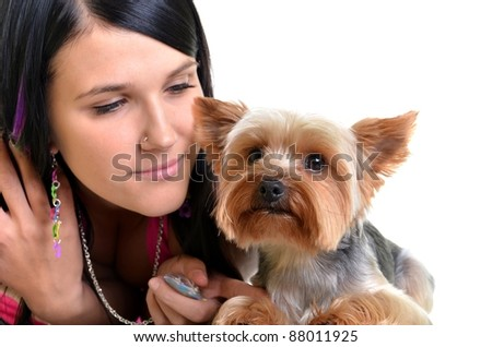 Young woman and sweet puppy playing around