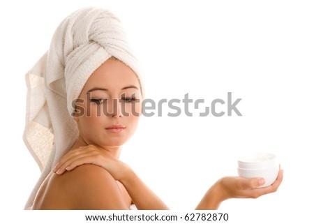 Young woman applying body cream - stock photo