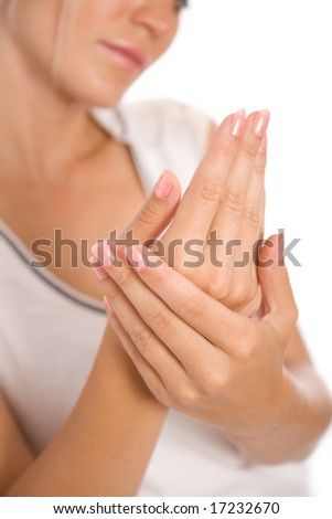 Young woman applying cream to hands. Focus point on a hands. - stock photo