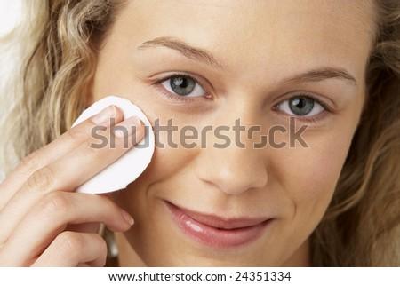 Young Woman Applying Make-Up - stock photo