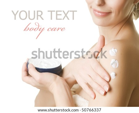 Young Woman applying moisturizer.Isolated on white - stock photo