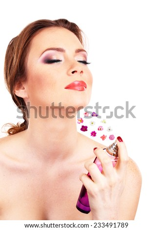 Young woman applying perfume isolated on white - stock photo