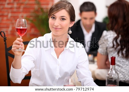 Young woman appreciating a glass of rose wine - stock photo
