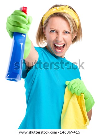 Young woman as a cleaning maid fiercely spraying liquid from blue sprayer, isolated over white - stock photo