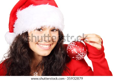 young woman as santa with red christmas bauble smiling