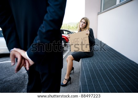 Young woman asking for a job, man looking indifferent - stock photo