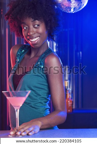 Young woman at a dance club - stock photo