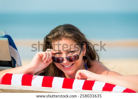 young woman at a resort in a deckchair - stock photo