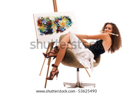 Young woman at atelier with canvas - stock photo