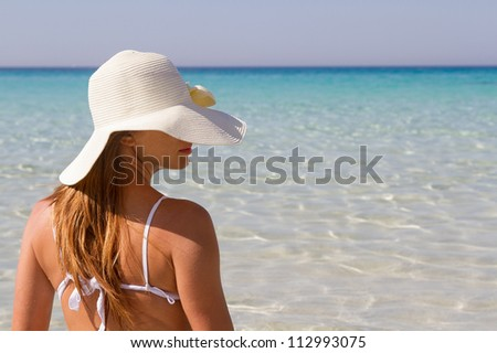 Young woman at beach of Lampedusa - stock photo