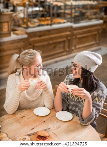Young woman at coffee shop - stock photo