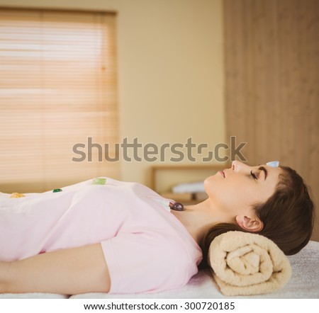 Young woman at crystal healing session in therapy room - stock photo