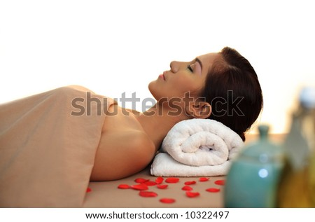Young woman at day spa getting therapy session - stock photo
