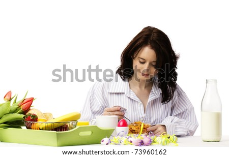young woman at easter breakfast eating corn flakes