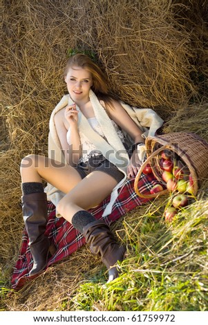 young woman at farm with many apple in basket