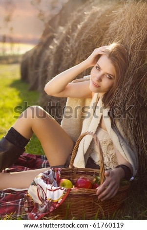 young woman at farm with many apple in basket - stock photo