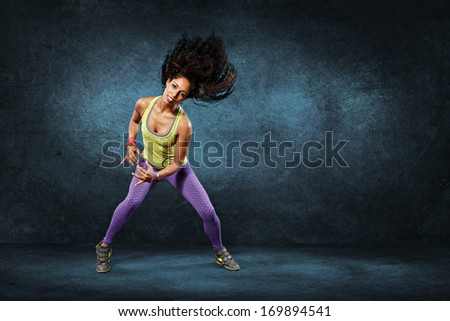 young woman at fitness exercise or zumba dancing - stock photo