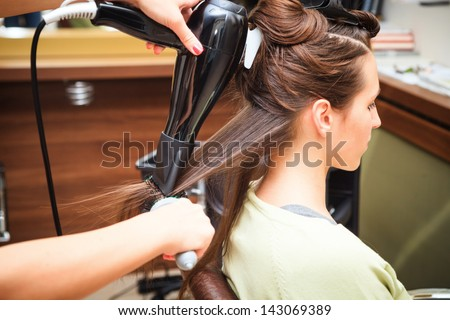 young woman at hairdresser do hairstyling