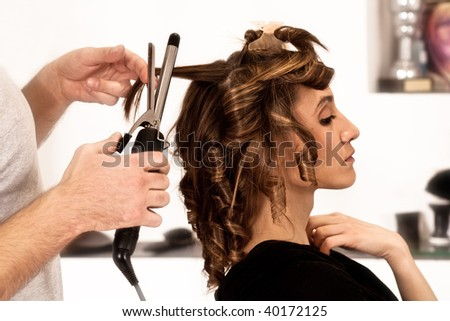 young woman at hairdresser, indoor shot - stock photo
