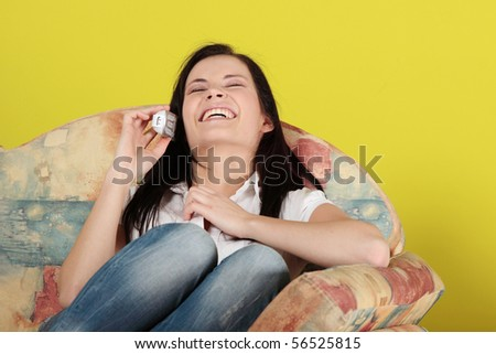 Young woman at home, talking by phone - stock photo