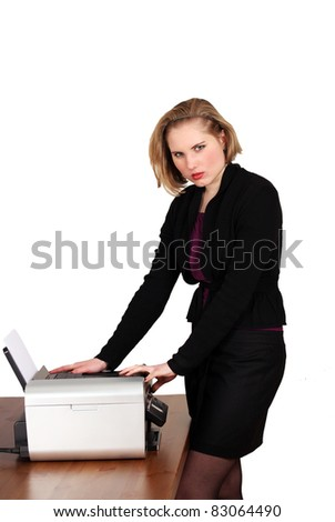 Young woman at office machine or photocopier - stock photo