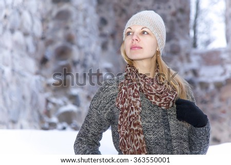 Young woman at old castle in winter