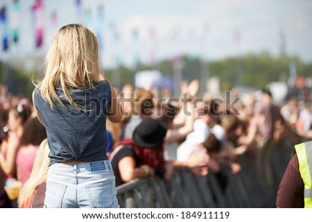 Young Woman At Outdoor Music Festival - stock photo
