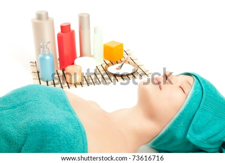 Young woman at spa procedures - stock photo