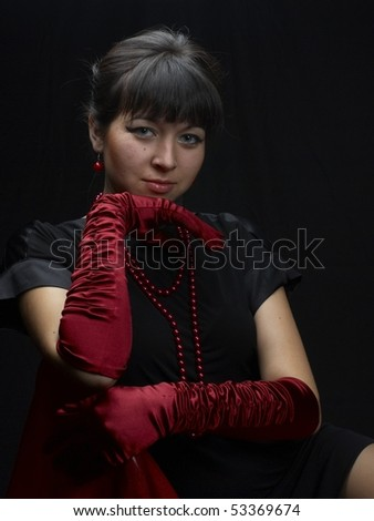Young woman at studio at black background