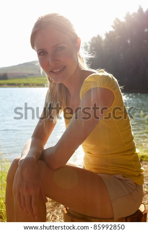 Young woman at sunset - stock photo