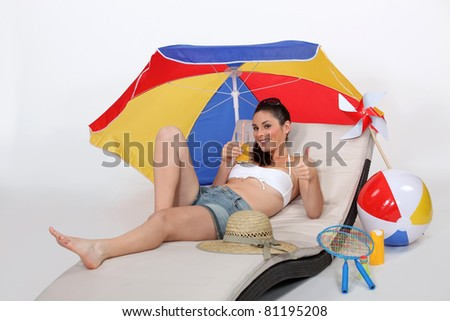 Young woman at the beach - stock photo
