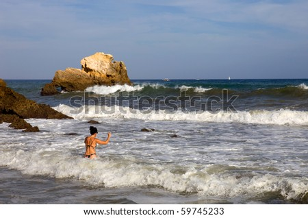 young woman at the beach having fun on the water - stock photo