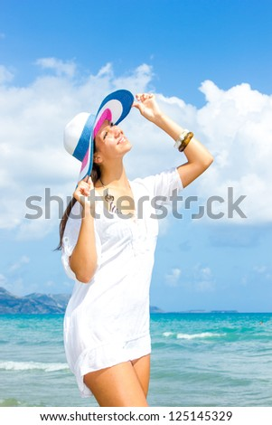 Young woman at the beach in the summertime