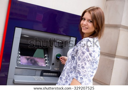 young woman at the cash machine - stock photo