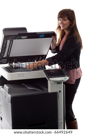 Young woman at the copy machine 9938 - stock photo