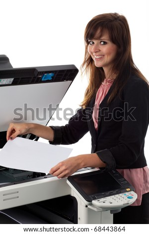 Young woman at the copy machine - stock photo