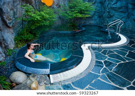 young woman at the hot thermal spa water pool of the Seorak Waterpia aquapark, Sokcho, South Korea - stock photo
