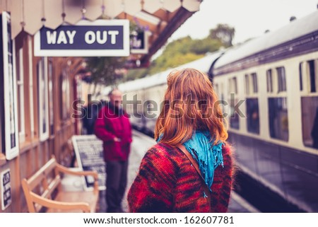 Young woman at train station - stock photo