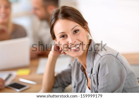 Young woman attending business training class - stock photo