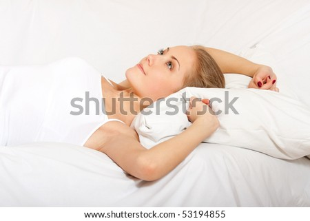 Young woman awaking. Isolated over white background. - stock photo