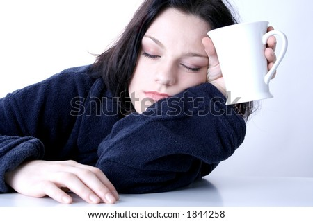 young woman awaking up early in the morning - stock photo