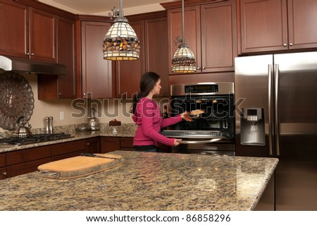 Young woman baking a bread - stock photo