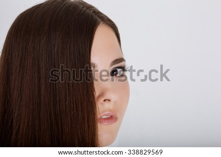 young woman beautiful cheerful enjoying with long strong brown hair isolated on white background - stock photo