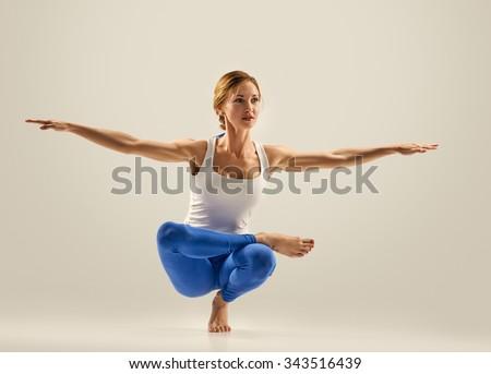 young woman beautiful yoga posing. studio background - stock photo