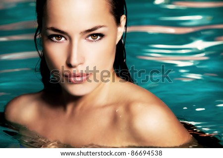 young woman beauty portrait in water - stock photo