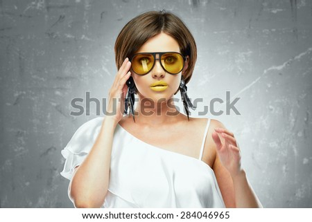 Young woman beauty portrait with yellow sun glasses. Face. Beautiful model. - stock photo
